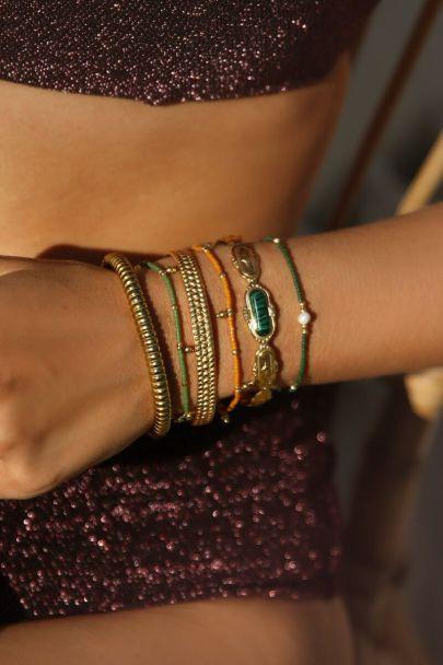 Armband met oranje kralen