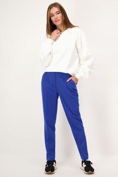 Blauwe pantalon met persvouwen