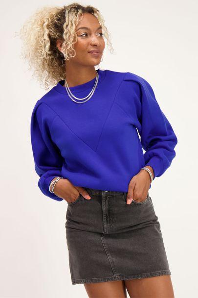 Blauwe sweater met V shape