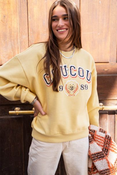 Gele sweater coucou