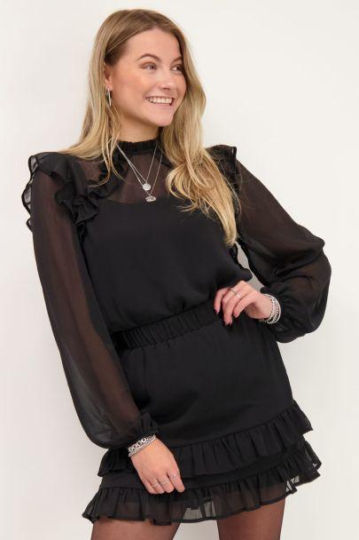 Zwarte doorschijnende blouse met ruffles