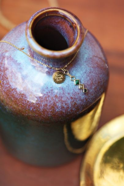 Necklace with charm & dark gemstones
