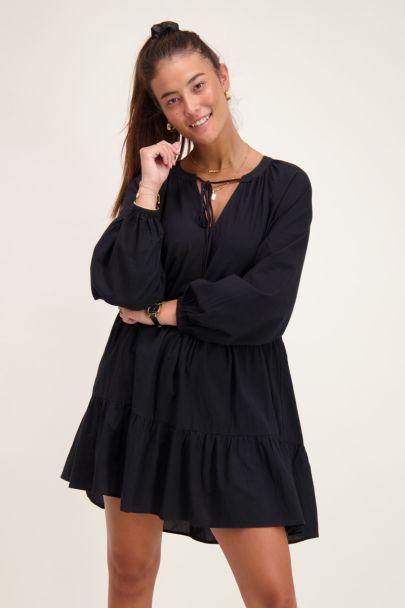 Wide-fitting black dress
