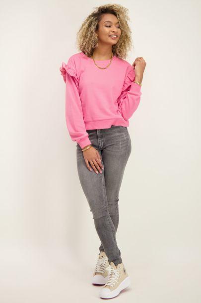 Roze sweater met ruffles