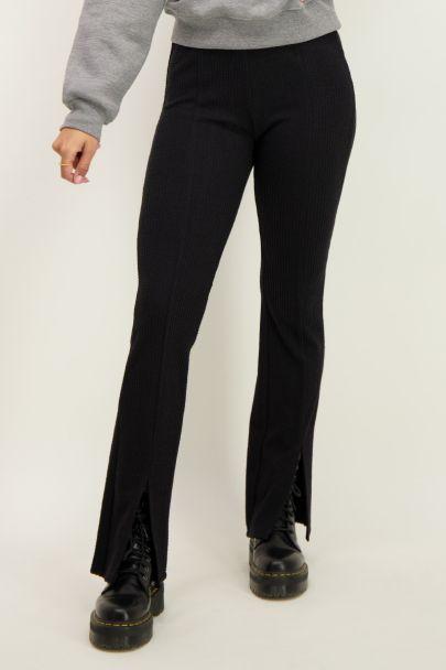 Flared pants met split