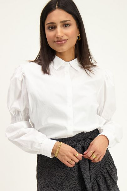 Witte blouse met smock mouwen