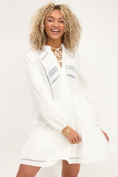 White loose-fitting dress with lace