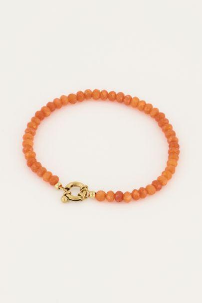 Oranje kralen armband met slotje