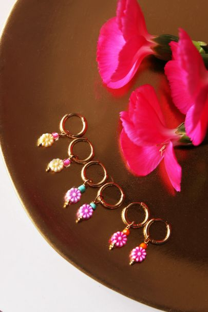 Earrings with yellow flower bead