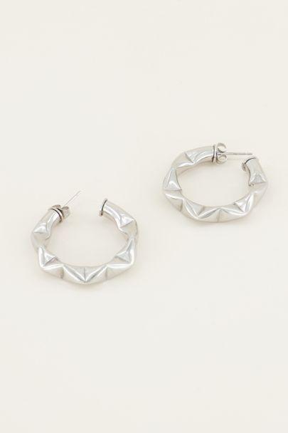 Wide earrings with pattern