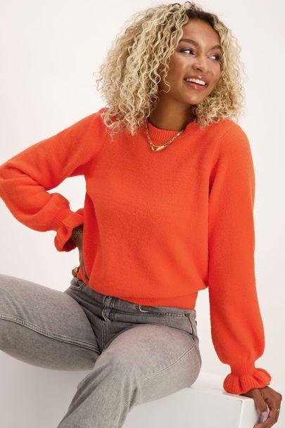 Oranje trui met ruffle mouwen