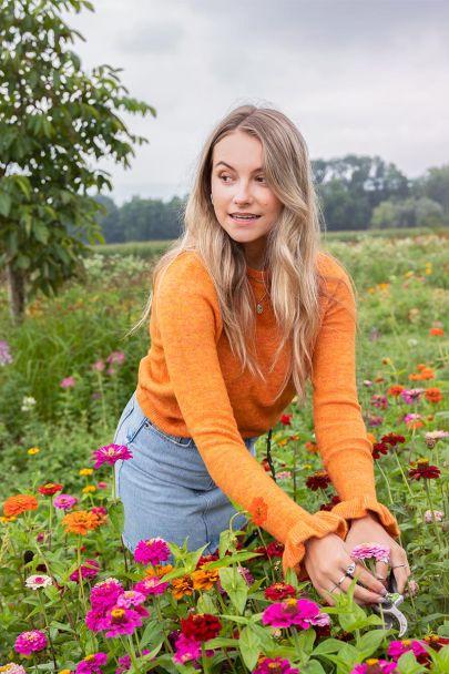 Oranje trui met ruffle mouw