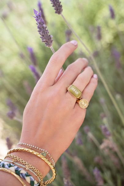 Green statement ring amour