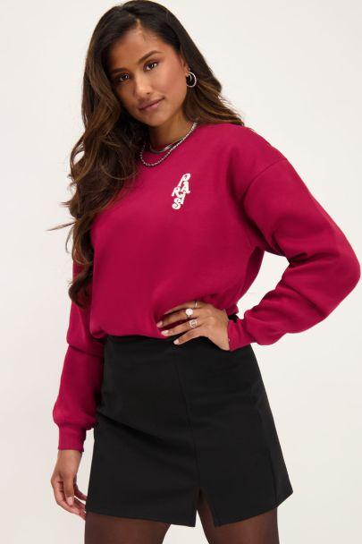 Rode sweater La Vie a Paris