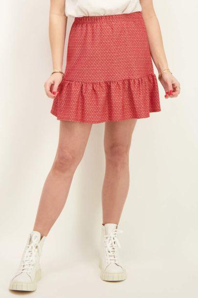 Pink skirt featuring bouclé and ruffles
