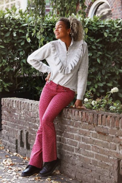 Pink flared pants with leopard print