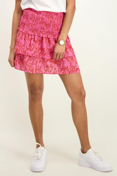 Pink skirt with red floral print