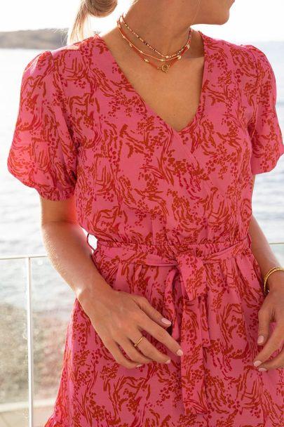 Roze jurk met rode bloemenprint
