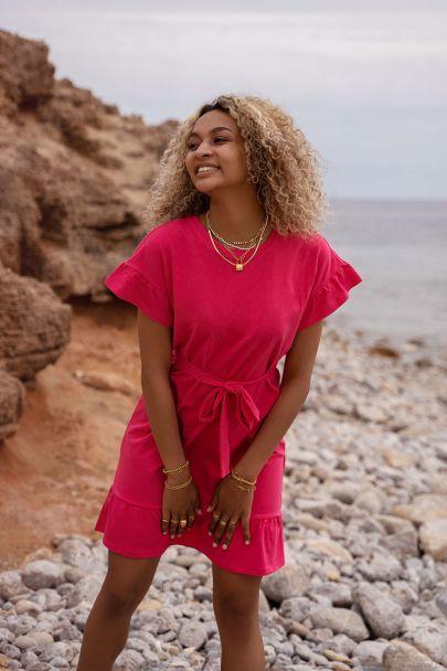 Roze jurk met strik & ruffles