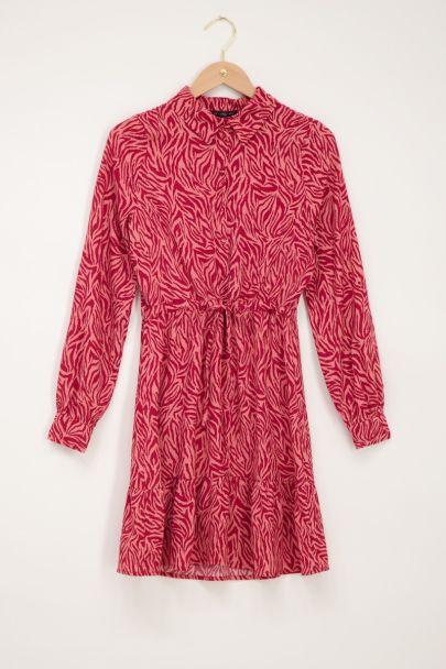 Pink dress featuring zebra print