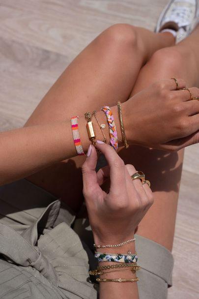 Roze bohemian armbandje gestreept