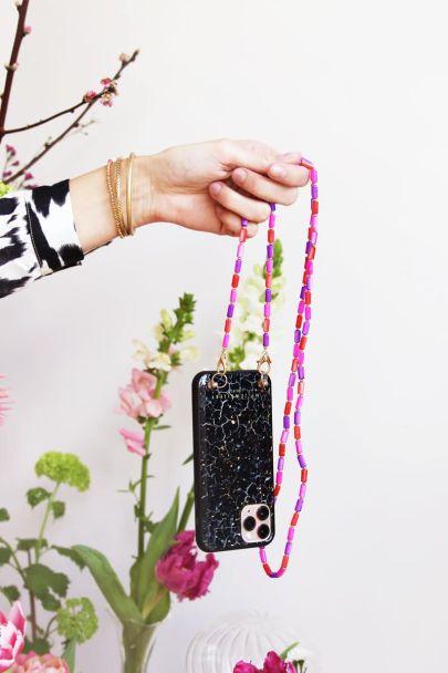 Telefoonkoord roze kralen