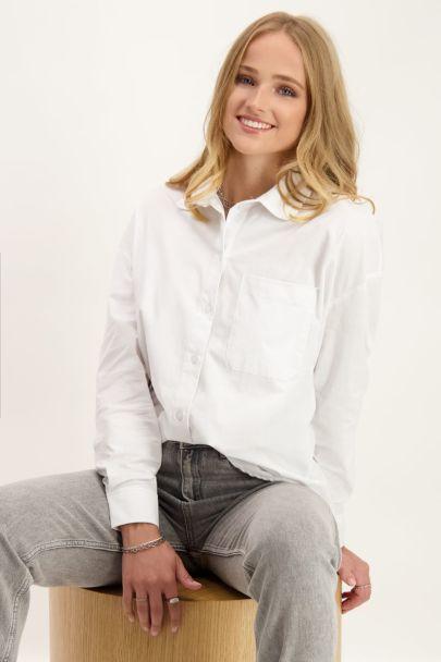 Witte blouse met borstzakje