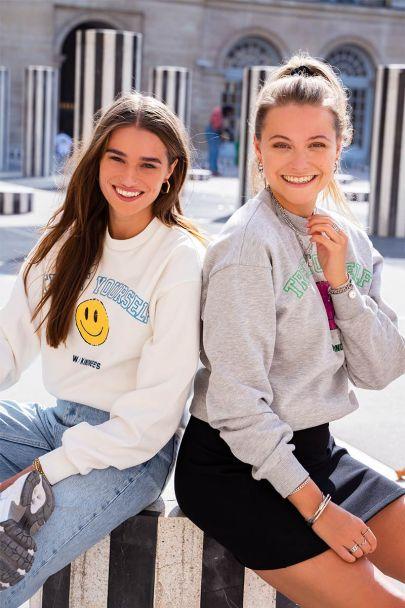 Witte sweater met smiley