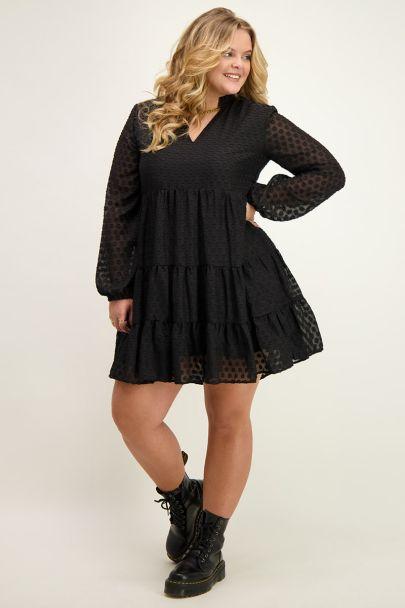 Wide-fitting black dress with V-neck