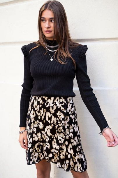 Black skirt with spotted print