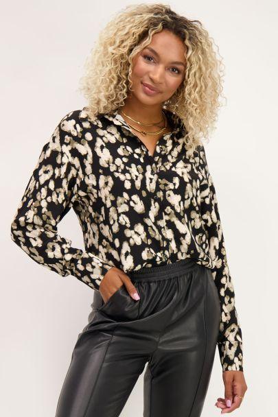 Zwarte blouse met gevlekte print