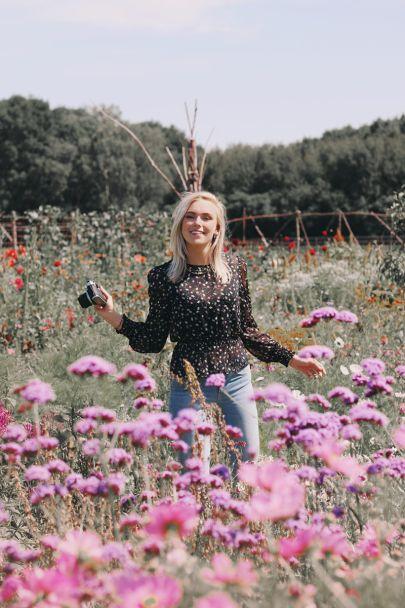 Zwarte blouse met bloemenprint
