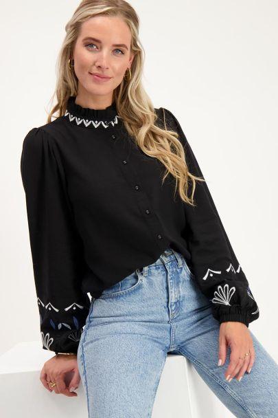 Zwarte blouse met witte embroidery