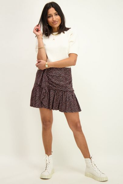 Black pleated skirt with print
