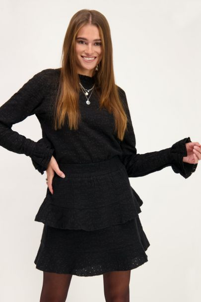 Black top with embroidery & ruffle