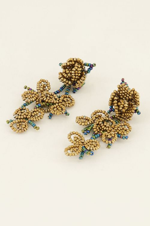 Earrings with beads and flower