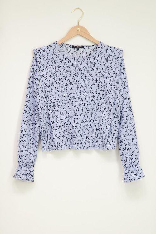 Blauwe blouse met bloempatroon in zwart
