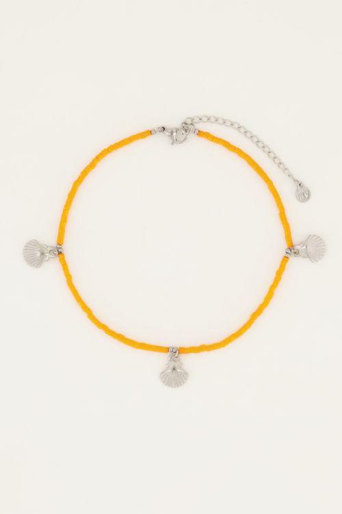 Oranje enkelbandje schelpjes
