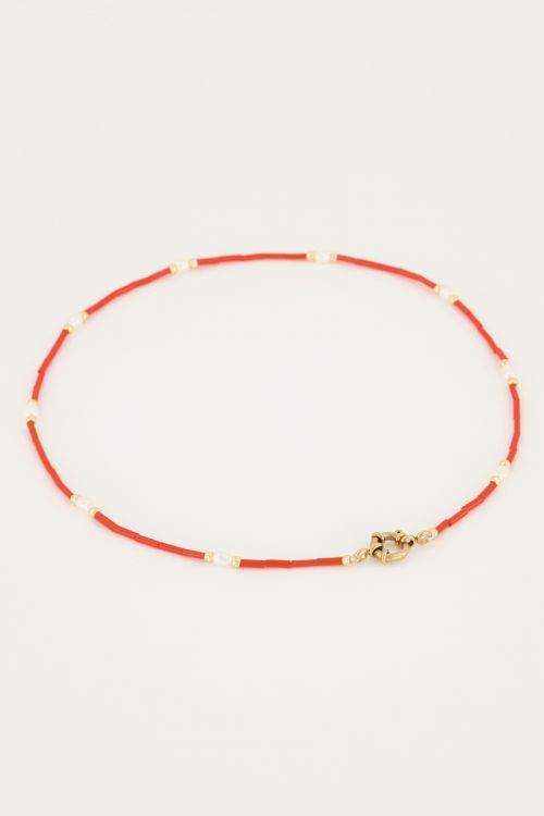 Oranje kralen ketting met slotje