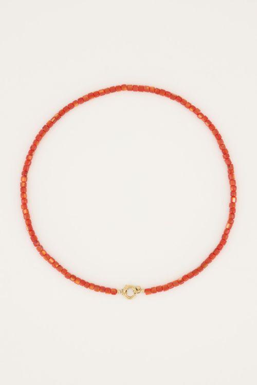 Oranje kralenketting met slotje