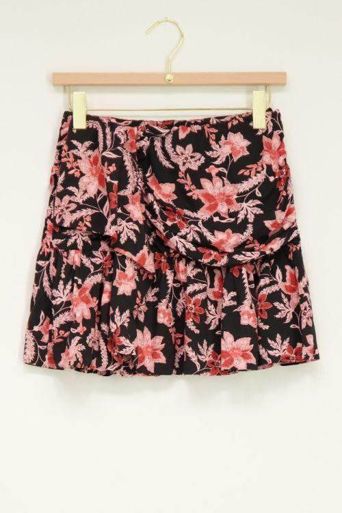 Zwart geplooide rok met bloemenprint