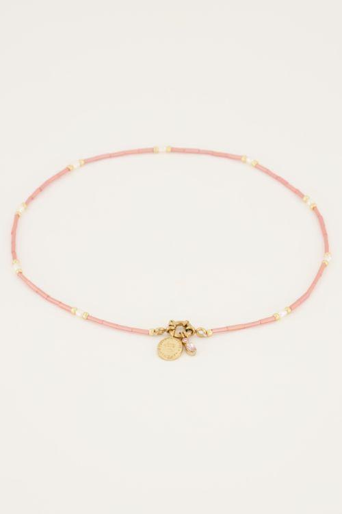 Roze kralen ketting met slotje en bedels