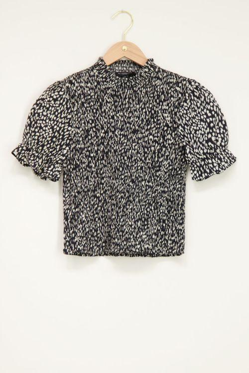 Zwart-witte top met smock & cheetah
