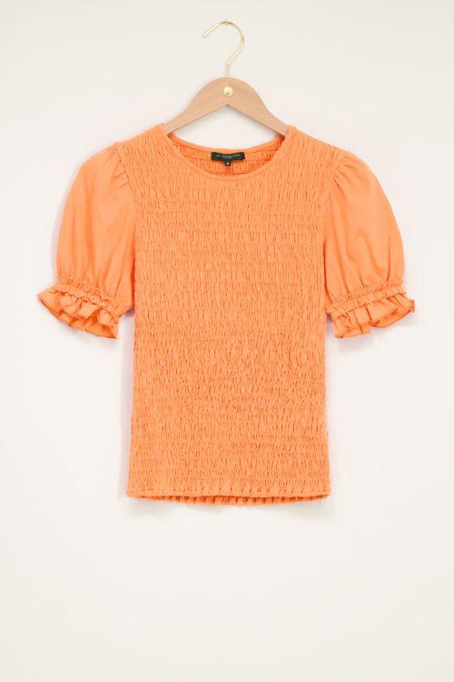 Oranje smock top met pofmouw