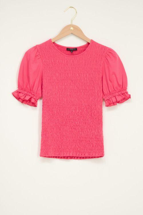 Roze smock top met ruffle pofmouw