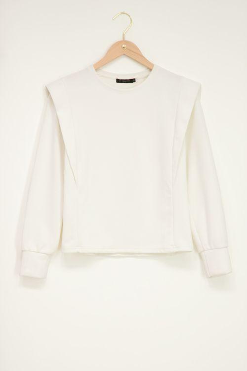 Witte sweater met schouderstukken