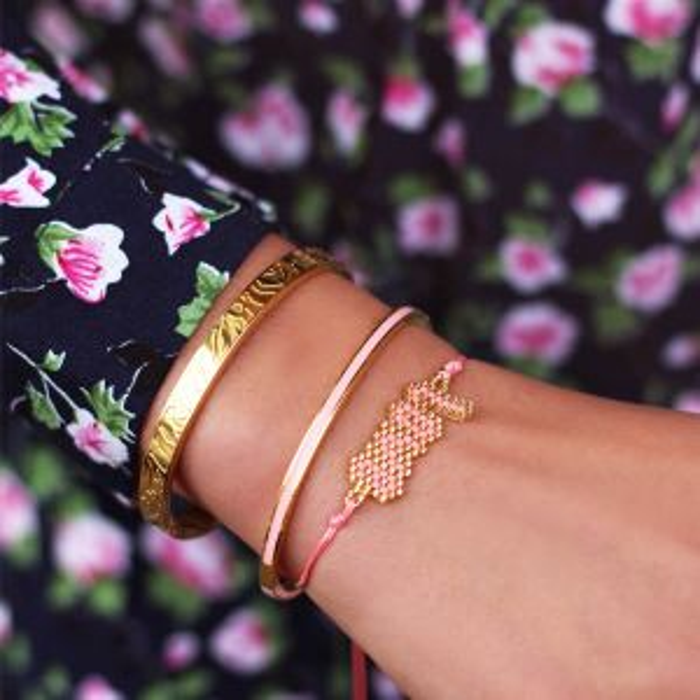 Roze kralen armband love